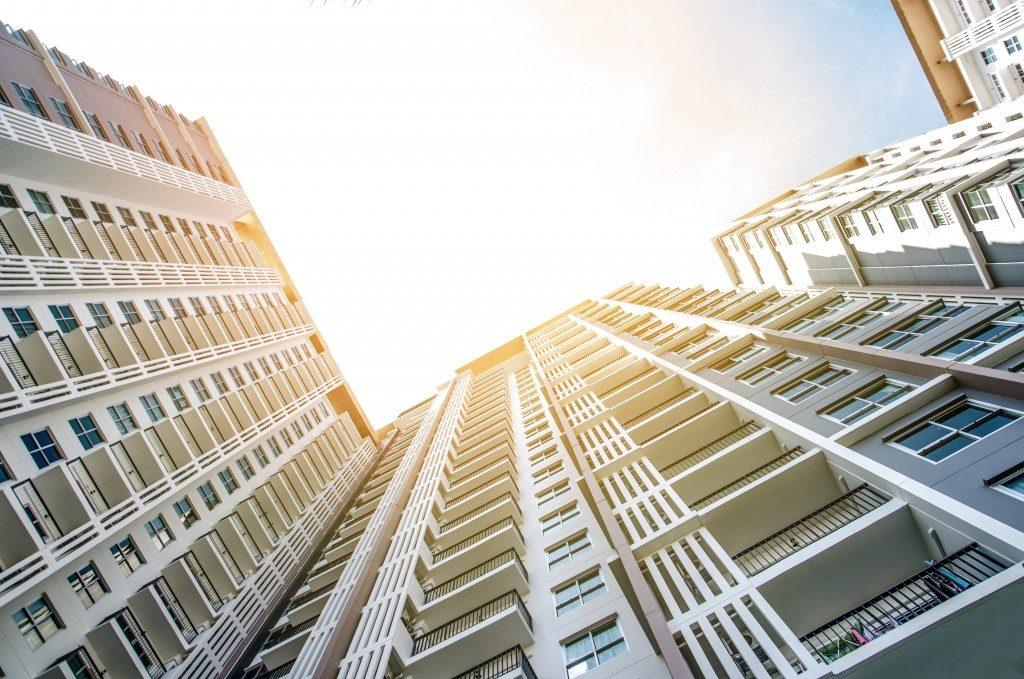 A condominium building shot from below