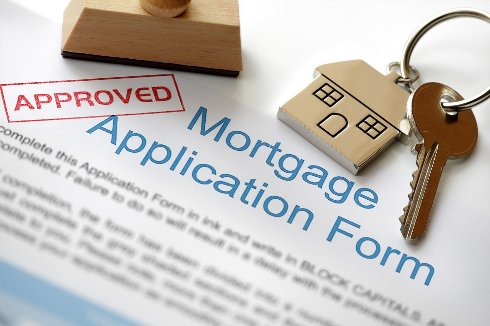 mortgage application form with house keys
