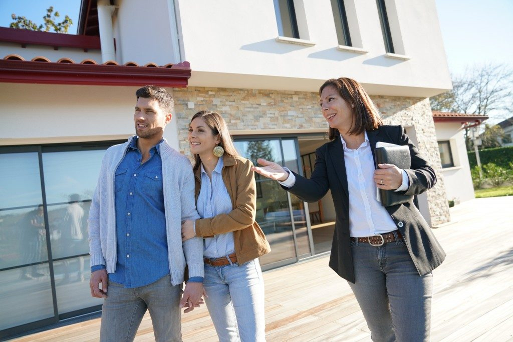 real estate agent assisting a couple buying a home