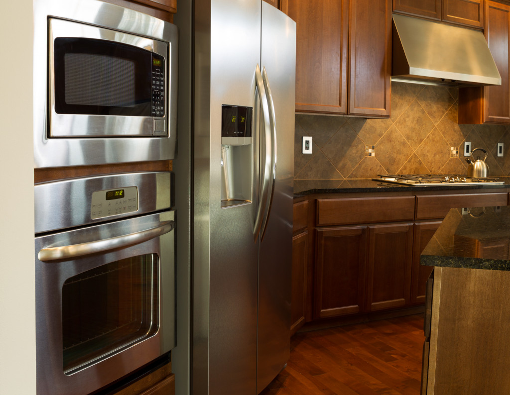 Closeup photo of a stainless steel appliances in modern residential kitchen